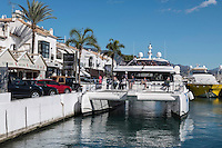 Fly Blue catamaran moored in Puerto Banus, Marbella, Malaga, Spain, to take on passengers for pleasure trip along the Costa del Sol coastline to Marbella, November, 2016, 201611073039<br /> <br /> Copyright Image from Victor Patterson, 54 Dorchester Park, <br /> Belfast, UK, BT9 6RJ<br /> <br /> t1: +44 28 9066 1296 (from Rep of Ireland 048 9066 1296)<br /> t2: +44 28 9002 2446 (from Rep of Ireland 048 9002 2446)<br /> m: +44 7802 353836<br /> <br /> e1: victorpatterson@me.com<br /> e2: victorpatterson@gmail.com<br /> <br /> www.victorpatterson.com<br /> <br /> Please see my Terms and Conditions of Use at www.victorpatterson.com. It is IMPORTANT that you familiarise yourself with them.<br /> <br /> Images used on the Internet must be visibly watermarked i.e. © Victor Patterson within the body of the image and copyright metadata must not be deleted. Images used on the Internet have a size restriction of 4kbs and will be chargeable at current NUJ rates unless advised otherwise.<br /> <br /> This image is only available for the use of the download recipient i.e. television station, newspaper, magazine, book publisher, etc, and must not be passed on to any third party. It is also downloaded on condition that each and every usage is notified within 7 days to victorpatterson@me.com<br /> <br /> The right of Victor Patterson to be identified as the author is asserted in accordance with The Copyright Designs And Patents Act (1988).