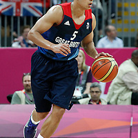 02 August 2012: Great Britain Andrew Lawrence brings the ball upcourt during 79-78 Team Spain victory over Team Great Britain, during the men's basketball preliminary, at the Basketball Arena, in London, Great Britain.
