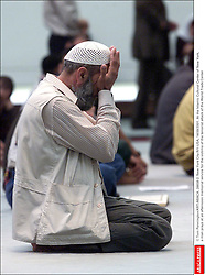 © Tom Pennington/KRT/ABACA. 28658-2. New York City-NY-USA, 14/09/2001. At the Islamic Cultural Center of New York, a man prays at an afternoon memorial service for the victims of the terrorist attack of the World Trade Center    28658_02