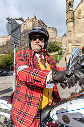 On Sunday September 30th 2018, over 120,000 distinguished gentlefolk in over 650 cities worldwide don their cravats, tustle their ties, press their tweed, and sit astride their classic and vintage styled motorcycles to raise funds and awareness for men's health, specifically prostate cancer and men's mental health.<br /> <br /> Pictured: A rider at the start of the Edinburgh Distinguished Gentleman's Ride in front of Edinburgh Castle