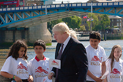 London, June 6th 2014. Mayor of London Boris Johnson chats to children from Alfred Salter Primary School as  they welcome the Commonwealth Games Queen's Baton Relay to the Capital.