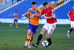 Sam Lavelle of Morecambe and Ollie Clarke of Mansfield Town tussle for possession - Mandatory by-line: Ryan Crockett/JMP - 27/02/2021 - FOOTBALL - One Call Stadium - Mansfield, England - Mansfield Town v Morecambe - Sky Bet League Two