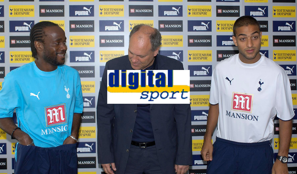 Photo: Daniel Hambury.<br />Tottenham Hotspur press conference. 07/09/2006.<br />Tottenham manager Martin Jol (C) checks out new signing Pascal Chimbonda (L) as fellow new recruit Mido looks on.