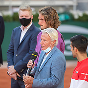 PARIS, FRANCE June 13.   Former Roland Garros champion Bjorn Borg present talks after presenting the winners trophy to Novak Djokovic of Serbia watched by Jim Courier, Stefanos Tsitsipas of Greece and FFT President Gilles Moretton after the Men's Singles Final at the 2021 French Open Tennis Tournament at Roland Garros on June 13th 2021 in Paris, France. (Photo by Tim Clayton/Corbis via Getty Images)