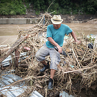 Francisco Lara walks around his house that is badly damaged by the flooding from hurricanes Eta and Iota in San Pedro Sula, Honduras