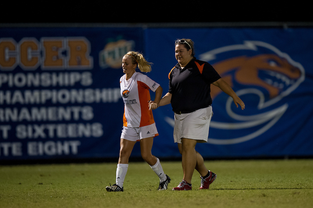 Sep 5, 2013; Morrow, GA, USA; Clayton State women's soccer trainer Stephanie Vasquez helps Nina Boganes during the game against Tampa at CSU. Both teams tied 3-3 in overtime. Photo by Kevin Liles/kevindliles.com