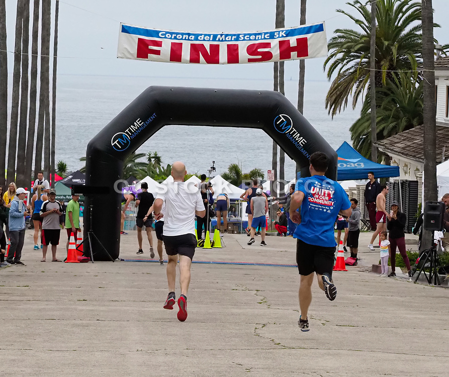 Runners Approaching the Finish Line at the Corona del Mar Scenic 5K