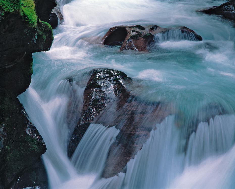 Water sheets from a boulder in Avalanche Creek, Glacier National Park, Montana.