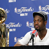 21 June 2012: Miami Heat shooting guard Dwyane Wade (3) answers journalists during a press conference following the Miami Heat 121-106 victory over the Oklahoma City Thunder, in Game 5 of the 2012 NBA Finals, at the AmericanAirlinesArena, Miami, Florida, USA. The Miami Heat wins the series 4-1.