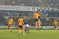 Steve Morison (captain) of Millwall beats Paul McShane (captain) of Reading to a header during the EFL Sky Bet Championship match between Millwall and Reading at The Den, London, England on 26 September 2017. Photo by Toyin Oshodi.