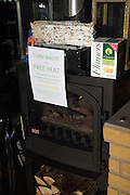 Display in solid fuel multi-fuel stove burner shop with paper waste bricks