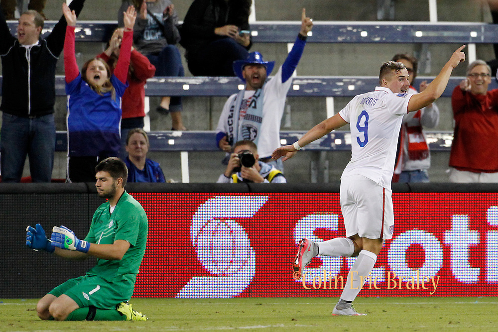 Canada goal keeper Max Crepeau (1) reacts as USA forward Jordan Morris (9) celebrates scoring his second goal of the match in the second half of a CONCACAF men's Olympic qualifying soccer match, Thursday, Oct. 1, 2015, in Kansas City, Kan. USA defeated Canada 3-1. (AP Photo/Colin E. Braley)