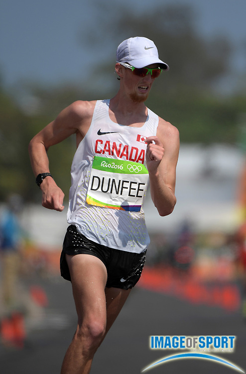 Aug 19, 2016; Rio de Janeiro, Brazil; Evan Dunfee (CAN) places fourth in the 50km race walk in a national record 3:41:38 during the Rio 2016 Summer Olympic Games at Pontal.