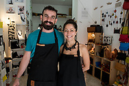 The Alab project combines many young artisans whose workshops are scattered throughout the Old Town, one of the main features of the production being on-site and in a single piece.. In this image Elena and Fabrizio of the Handmade Lab