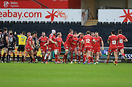 Scarlets players start to celebrate in the final few seconds of the game as they win a late penalty. Guinness Pro12 rugby match, Ospreys v Scarlets at the Liberty Stadium in Swansea, South Wales on Saturday 26th March 2016.<br /> pic by  Andrew Orchard, Andrew Orchard sports photography.