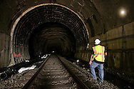 Engineer and inspector Reginal Raphael shines a flashlight beam on the side of the Otisville Tunnel on Thursday, June 20, 2013. MTA Metro-North Railroad is repairing the rock section  of the mile-long tunnel.