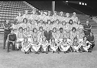 Football - Huddersfield Town Full team with youth Photocall 1974 / 75 season. 01/08/1974<br /> Back row : L to R. Les Chapman , Roy Ellam , John Saunders ,Terry Poole , Dick Taylor ,Alan Gowling ,Terry Dolan ,Geoff Hutt , John Dungworth.<br /> 2nd row : Brian Hustler (physio), Graham Pugh ,Phil Summerill ,Graham McGifford , Steve Smith ,  Brian Marshall , Martin Fowler ,Paul Garner ,Francis Firth , Robert Newton , Roy McLaren (coach).<br /> Sitting : Terry Cockburn (coach), Jimmy Lawson ,Bobby Hoy , Steve Spriggs , Mick Fairclough ,Bobby Collins ( Manager ) Bob Mountain , Lloyd Maitland , Terry Gray , Alan Sweeney , Dave Nicols , Robin Wray (coach) <br /> On ground - Peter Howey Terry Armstrong , Stephen Barrett , Paul Cooper , Wayne Goldthorpe , Peter Hart , David Wright.