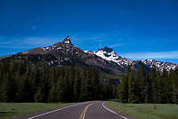 The Beartooth Highway is a 68 mile long road that starts in Red Lodge, Montana, and ends at the northeast entrance to Yellowstone. The steep, winding highway reaches elevations above 10,000 feet and is known for getting snow anytime of the year. Snow drifts up to 40 feet high were encountered earlier in the day. This shot was taken at 11PM when the moon was illuminating Pilot and Index Peaks. Resembling the Matterhorn in the Alps, Pilot Peak can be seen near the end of the highway outside of Cooke City. The twin stars of Gemini as well as the Beehive star cluster were setting behind the two peaks.