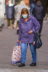 © Licensed to London News Pictures. 22/11/2020. Hull, UK. Photo credit:  A shopper wears a face covering in Hull city centre. Hull is to face stricter measures following lockdown to reduce the spread of the Coronavirus, as 751.4 per 100000 people is reported, and the numbers keep increasing daily.  Photo credits:  Ioannis Alexopoulos/LNP