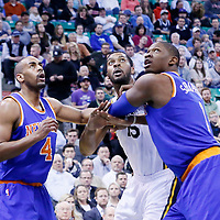 09 December 2015: Utah Jazz forward Derrick Favors (15) vies for the rebound with New York Knicks guard Arron Afflalo (4) and New York Knicks center Kevin Seraphin (1) during the Utah Jazz 106-85 victory over the New York Knicks, at the Vivint Smart Home Arena, Salt Lake City, Utah, USA.