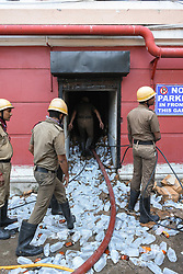 October 3, 2018 - Kolkata, West Bengal, India - Fire fighetrs entering the pharmacy storage. (Credit Image: © Debarchan Chatterjee/Pacific Press via ZUMA Wire)