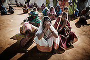 Christian refugees pray at the Tikabali High School campus in Orissa's Kandhamal district, some 350 kms southwest of Bhubaneswar. Nov. 06, 2008.