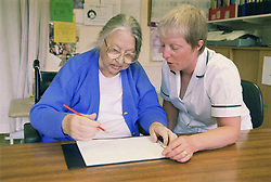 Occupational therapist with patient doing line cancellation test; which assesses inattention following stroke,