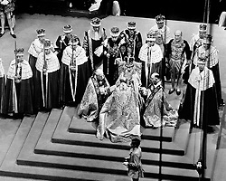 The new Queen, Elizabeth II, on the throne as the bishops pay homage to her during the Coronation of 1953.