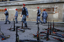 Members of the Lebanese Internal Security Forces prepare to patrol the streets, Beirut, Lebanon, March 22, 2006. The militias involved in the civil war were stripped of their weapons and dissolved into the police and armed forces at the conflict's end. Today, Hezbollah remains the only group with weapons outside of the Lebanese Army, but many contend this is to protect the country from another Israeli invasion. This remains a contentious issue in Lebanese and international politics.