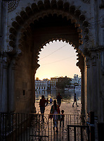 UDAIPUR, INDIA - CIRCA NOVEMBER 2016:  Gate and pedestrian access to Lake Pichola at sunset in Udaipur