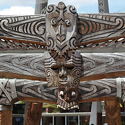 Wood carvings at the carved contemporary entrance to Te Puia, Rotorua. Te Puia is the premier Maori cultural centre in New Zealand - a place of gushing waters, steaming vents, boiling mud pools and spectacular geysers. Te Puia also hosts National Carving and Weaving Schools and  daily maori culture performances including dancing and singing. Rotorua, 8th December 2010 New Zealand.  Photo Tim Clayton
