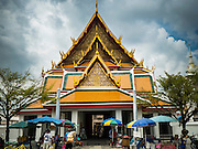11 SEPTEMBER 2015 - BANGKOK, THAILAND:  Wat Kalayanamit. Authorities started to destroy 54 homes in front of Wat Kalayanamit, a historic Buddhist temple on the Chao Phraya River in the Thonburi section of Bangkok. Government officials, protected by police, seized the house of Chaiyasit Kittiwanitchapant, a Kanlayanamit community leader, who has led protests against the temple's abbot for trying to evict community members whose houses are located around the temple. Work crews went into Chaiyasit's home and took it apart piece by piece. The abbot of the temple said he was evicting the residents, who have lived on the temple grounds for generations, because their homes are unsafe and because he wants to improve the temple grounds. The evictions are a part of a Bangkok trend, especially along the Chao Phraya River and BTS light rail lines, of low income people being evicted from their long time homes to make way for urban renewal.        PHOTO BY JACK KURTZ
