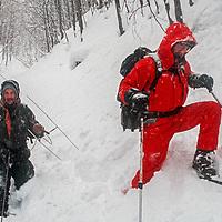 David Quammen & Peter Suerth track a wolf in trhe Carpathian Mountains near Zarnesti, Romania.