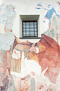 Church at Kostenberg, near Velden, on the Alpe Adria Trail, Carinthia, Austria. There are fragmentary murals on the south wall of the church exterior. © Rudolf Abraham
