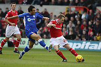 Photo: Pete Lorence.<br />Nottingham Forest v Millwall FC. Coca Cola League 1. 25/11/2006.<br />John Curtis slams the ball upfield as Chris Hackett attempts a tackle.