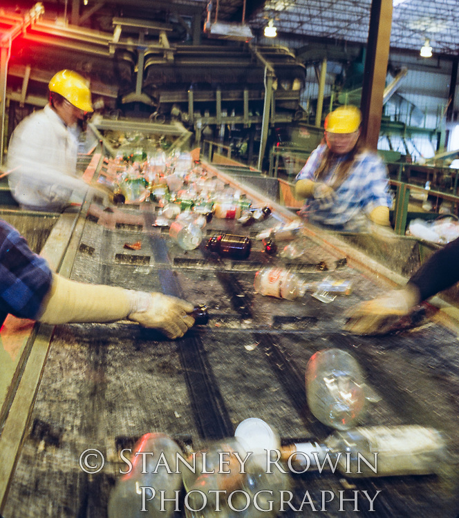 sorting glass bottles in Recycling Plant