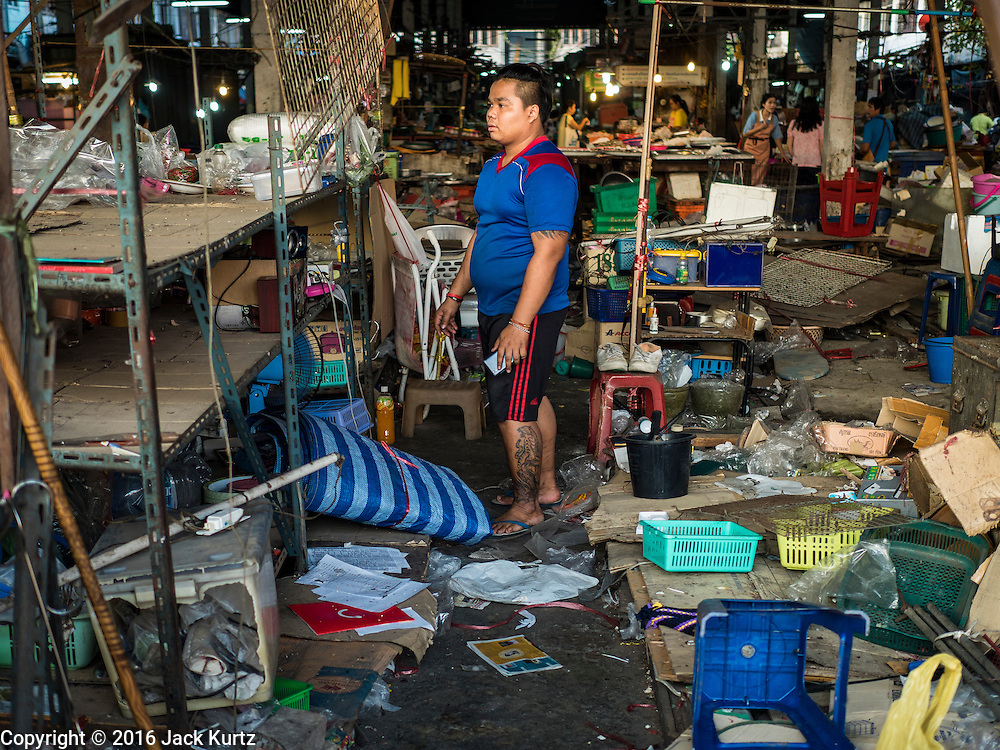 04 JANUARY 2016 - BANGKOK, THAILAND:        A vendor packs up his housewares shop in Bang Chak Market on the last day the market was open. The market closed January 4, 2016. The Bang Chak Market serves the community around Sois 91-97 on Sukhumvit Road in the Bangkok suburbs. About half of the market has been torn down. Bangkok city authorities put up notices in late November that the market would be closed by January 1, 2016 and redevelopment would start shortly after that. Market vendors said condominiums are being built on the land.     PHOTO BY JACK KURTZ