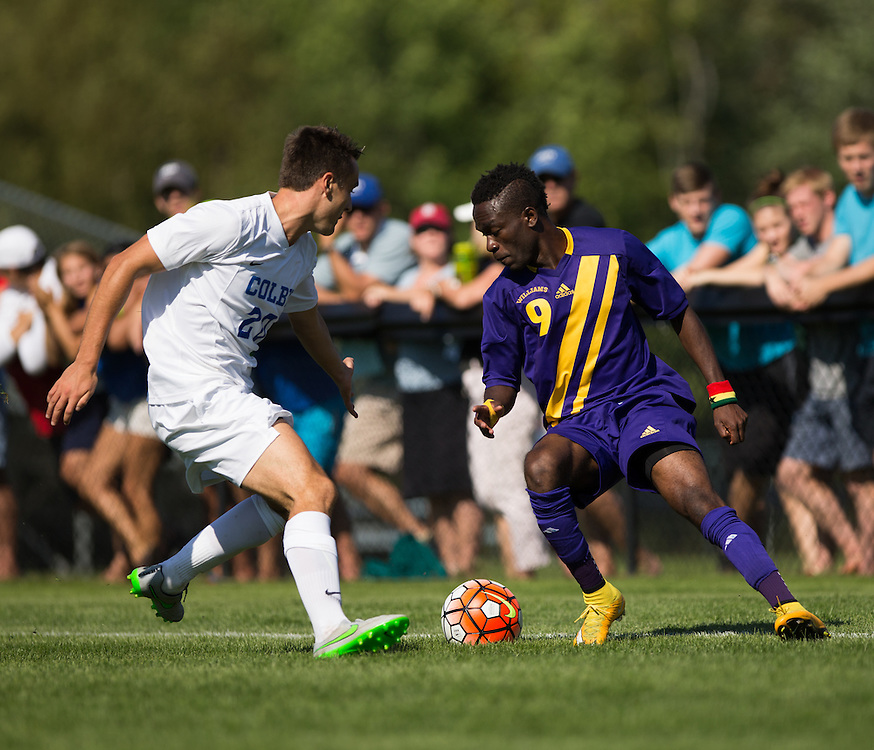 Evan Dwyer of Colby College tries to defend Mohammed Rashid of Williams College during a NCAA Division III soccer game on September 19, 2015 in Waterville, ME. (Dustin Satloff/Colby College Athletics)