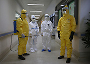QINGDAO, CHINA - SEPTEMBER 16: (CHINA OUT) <br /> <br /> Staff do medical inspection exercise to prevent Ebola virus on October 16, 2014 in Guangzhou, Guangdong province of China. An Ebola-preventing exercise gets held in Guangzhou on Thursday. 236 medical staff were killed by Ebola virus up to now.<br /> ©Exclusivepix