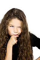 caucasian little girl portrait pucker  pensive thinking mistrust isolated studio on white background