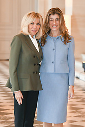 French President's wife Brigitte Macron welcomes Spanish Prime Minister's wife Maria Begona Gomez Fernandez as they take part in a spousal event at the Chateau de Versailles in Versailles, near Paris, on November 11, 2018 as part of commemorations marking the 100th anniversary of the 11 November 1918 armistice, ending World War I. Photo By Laurent Zabulon/ABACAPRESS.COM