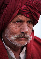 PUSHKAR, INDIA - CIRCA NOVEMBER 2016: Portrait or Rajasthani farmer at Pushkar Camel Fair grounds. It is one of the world's largest camel fairs. Apart from the buying and selling of livestock, it has become an important tourist attraction.