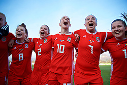 ZENICA, BOSNIA AND HERZEGOVINA - Tuesday, November 28, 2017: Wales' Angharad James, Loren Dykes, Jessica Fishlock and Natasha Harding celebrate the 1-0 victory over Bosnia and Herzegovina during the FIFA Women's World Cup 2019 Qualifying Round Group 1 match between Bosnia and Herzegovina and Wales at the FF BH Football Training Centre. (Pic by David Rawcliffe/Propaganda)