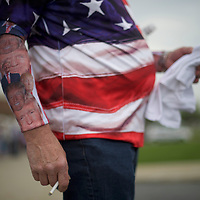 HARRISBURG, PA - APRIL 21:  Chris Wolfersberger, 62, smokes a cigarette, with Donald Trump themed socks worn on his forearms, before the Republican presidential hopeful holds a campaign rally at the Pennsylvania Farm Show Complex & Expo Center on April 21, 2016 in Harrisburg, Pennsylvania.  The Pennsylvania Primary takes place on April 26.  (Photo by Mark Makela/Getty Images)
