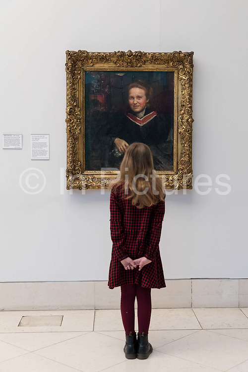 Stella Cartwright, aged 9, views Annie Swynnerton's oil portrait of the suffragist, Millicent Fawcett, which is displayed at Tate Britain art gallery on 2nd February 2018 in London, England, United Kingdom, to mark the centenary anniversary of of the Representation of the People Act, which gave women over 30 the right to vote. The suffragist, Fawcett was a political and union leader and writer known for her work as a campaigner for women to have the vote. Swynnerton was a pioneering artist, one of the first women to be elected a member of the Royal Academy of Arts and a strong advocate of women's rights.