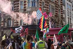 Environmental activists from Extinction Rebellion use a giant table to block roads in the Covent Garden area during the first day of Impossible Rebellion protests on 23rd August 2021 in London, United Kingdom. Extinction Rebellion are calling on the UK government to cease all new fossil fuel investment with immediate effect. (photo by Mark Kerrison/In Pictures via Getty Images)