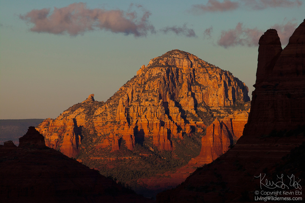 Wilson Mountain, the tallest of the red and white sandstone peaks near Sedona, Arizona, is framed by other formations. Wilson Mountain has an elevation of 7,122 feet (2171 meters), and its summit provides some of the grandest views in northern Arizona.