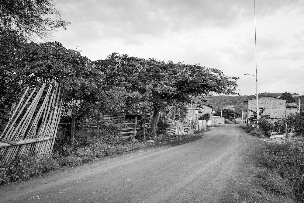 """2015/03/13 - Pile, Ecuador: Street life in the quiet village of Pile in the Manabí province. The village is far from any modernity. It's main production it is still the """"Montecristi hats"""", commonly known internationally as the """"Panamá Hats"""". The number of craftsmen in the village is declining. Competition from China and the Ecuadorian city of Cuenca that have bigger production and cheaper prices, make hard to make a living to the craftsmen of Pile."""