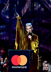 Pink accepts the award for Outstanding Contribution on stage at the Brit Awards 2019 at the O2 Arena, London.