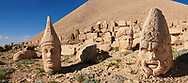 Statue head, from left, Antiochus, Commenge & Zeus, in front of the 62 BC Royal Tomb of King Antiochus I Theos of Commagene, west Terrace, Mount Nemrut or Nemrud Dagi summit, near Adıyaman, Turkey .<br /> <br /> If you prefer to buy from our ALAMY PHOTO LIBRARY  Collection visit : https://www.alamy.com/portfolio/paul-williams-funkystock/nemrutdagiancientstatues-turkey.html<br /> <br /> Visit our CLASSICAL WORLD HISTORIC SITES PHOTO COLLECTIONS for more photos to download or buy as wall art prints https://funkystock.photoshelter.com/gallery-collection/Classical-Era-Historic-Sites-Archaeological-Sites-Pictures-Images/C0000g4bSGiDL9rw